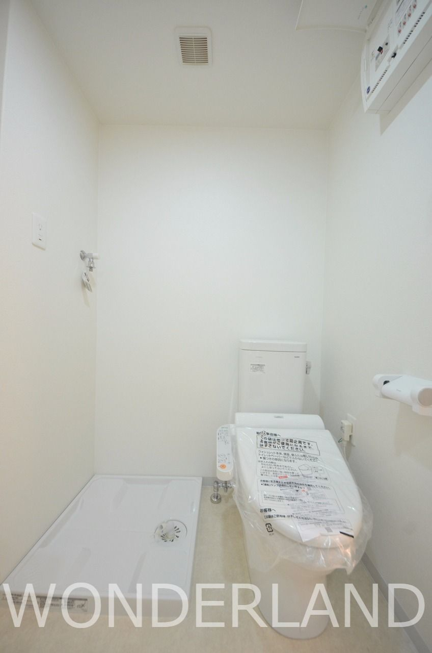 脱衣場にトイレのあるアメリカンセパレートタイプ